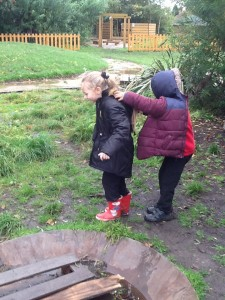 Tia talking clearly to help lead Faizan around the woodland...